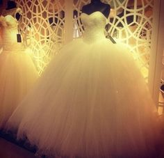 If this isn't a ball gown wedding dress, I don't know what is. I love all the tulle!