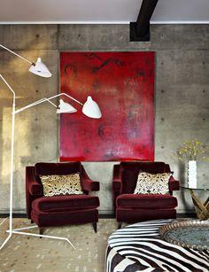 Merlot burgundy velvet chairs, concrete wall finish, modern wall art, Serge Mouille Three-Arm Floor Lamp? Modern Home by Jamie Bush