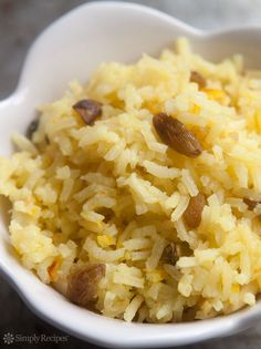 Saffron Rice Pilaf ~ Saffron rice, an Indian rice pilaf seasoned with saffron, cardamom, cinnamon, cloves, orange zest, pistachios, and almonds. Also called parsi pulao. ~ SimplyRecipes.com