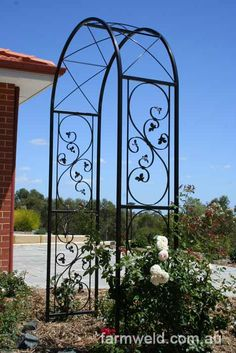 Custom made, ornamental wrought iron garden arch, powder coated black.