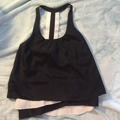 Black and white top from marshalls Cute black and white top that has never been worn. Has a very adorable back and ruffles at the bottoms. I love it! I just haven't got around to wearing it!:) Fun and flirt Tops