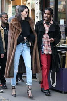 Furry nice: Maintaining her glamour for her low-key outing however, the Victoria's Secret catwalk star layered a striking and luxurious brown fur coat on top
