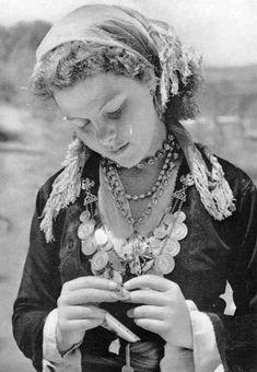 """National Geographic Magazine  May 14. 1945 Vol XXXIII, No 30. """"This girl of moden Crete is wearing jewlery like that her grandmothers ware centuries ago on this ancient island..."""" Photographer B. Antony Stewart"""