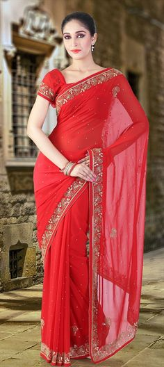 130203: Red and Maroon color family Saree with matching unstitched blouse.