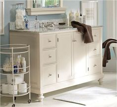 PB-inspired turned leg console, to inspire vanity redo (remove old base and replace with furniture legs)