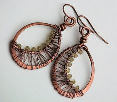 The crescent moon wire wrapped earrings from Owl Hollow Studio are handmade from copper.  Hand forged and hammered to shape, the outer frame of each earring is an oval hoop. To one side of each ear