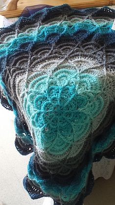 Learn the Tunisian Crochet Smock Stitch Ravelry: Jennileete's Mandala Blue Flower Puddles Ripples Blanket Crochet Afghans, Tunisian Crochet, Crochet Squares, Crochet Patterns Amigurumi, Crochet Blanket Patterns, Ravelry Crochet, Crochet Blanket Flower, Ripple Crochet Blankets, Crotchet Blanket