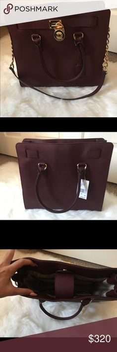 Micheal Kors large merlot Hamilton bag This beauty is in need of a good home. She's never been used or worn. Tags are still on, she's a beautiful merlot color, great for fall or anytime. Looking for price above or best offer. Thanks for shopping! Michael