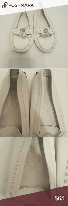 Tod's White Leather Loafers Size 7.5  Tod's White Leather Loafers  Some marks under the silver accent as pictured. Not noticeable when wearing.  Otherwise in great condition. Tod's Shoes Flats & Loafers