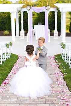 Snapshots of the ring bearer and flower girl stealing a kiss or sheepishly interacting together are too cute for words.