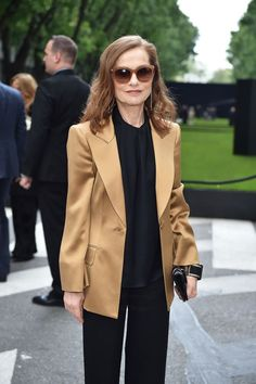 12 Women Who Chose Power Suits Over Party Dresses #refinery29  http://www.refinery29.com/armani-suit-party-pics#slide-8  Isabelle Huppert looking fresh to death in an oversized gold blazer. ...