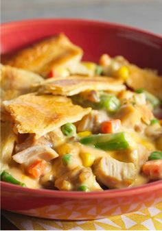 "Easy Cheesy Chicken Pot Pie – With words like ""easy"" and ""cheesy"" in the name, what's not to like about this delicious recipe? #TwistThatDish"
