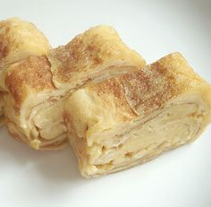 Tamagoyaki!  I like to make a 4-egg one on Sunday night and use it in bentos all week Note: doesn't need salt