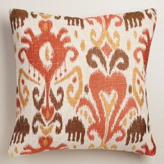Featuring an ikat design in warm red hues and a unique woven texture, our exclusive throw pillow is a dream when it comes to decorating. Toss a couple on your sofa to punch up your decor instantly and affordably.
