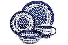 16 Piece Set in Flowering Peacock - the set includes 4 Dinner Plates, 4 Dessert Plates, 4 Cereal/Soup Bowls and 4 Coffee Mugs.    bluerosepottery.com
