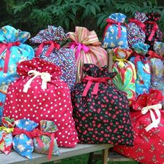 easy to sew reusable gift bags.  Great idea for fellow-sewing freaks!  Like a gift WITH a gift :)