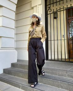 Silk shirt, wide leg pants, sandals, belt bag and fedora | For more style inspiration visit 40plusstyle.com