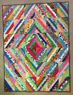 I finished this little string diamond quilt over the weekend. It ended up about 36x48 inches, just right for a baby quilt.     My niece and ...