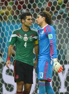 Mexico Erupts For Late Goals To Defeat Croatia, Advance To Round Of 16 - Mexico's defender Rafael Marquez and Mexico's goalkeeper Guillermo Ochoa talk during a Group A football match between Croatia and Mexico at the Pernambuco Arena in Recife during the 2014 FIFA World Cup on June 23, 2014.