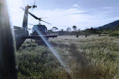 Helicopters from the 170th Assault Helicopter Company waiting to retrieve soldiers from the field.