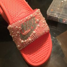 c2b332d76900 blinged Nike slides Nike slides in any color with beads glued to it. All  shoe sizes are available