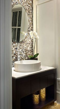 Tile backsplash behind your mirror in a small bathroom