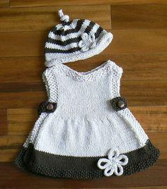 Wunderschönes Kleidchen mit Mütze in Anthrazit-Weiß.Das abgebildete Kleid ist in Größe 62,Mütze Kopfumfang 42cm.