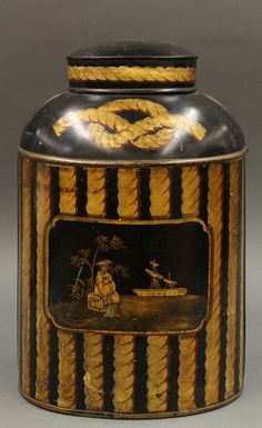 "Chinoiserie tole decorated tin tea canister, second half 19th century, the black body with gilt accents centered by a scenic reserve depicting a sailing vessel at sea, a countryman seated on a crate under a tree gazing outward, 19""h x 12""w"
