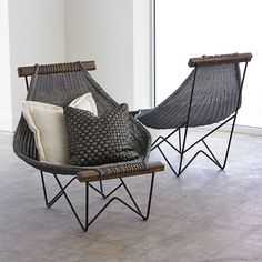 Sink deeply and relax into the Spinnaker Chair which takes its name from a wind-filled sail. The weave was inspired by a vintage technique and is hand-woven by artisans in Vietnam. The gray-washed rattan chair sits upon an iron, powder-coated base; acacia wood frame. Not intended for outdoor use.