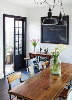 Dining room. The dining table is aFrench walnut bistro table,... mismatched chairs, white walls