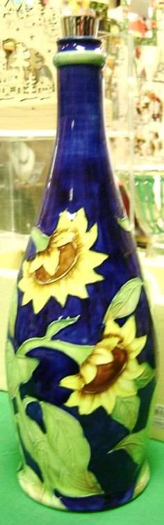 "Hand Painted Sunflower Wine Bottle ($64.99) - Approximately 11.5"" Tall; Artist-signed food-safe bottle from Benaya Ceramic Arts, British Columbia"