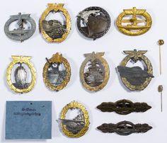 Lot 354: World War II German Navy Badge Assortment; Thirteen items including badges for high seas, blockade running, coast artillery, destroyer, U-boat, E-boat and mine sweeping
