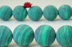 32 pcs of Green Malachite matte Synthetic round beads in 12mm