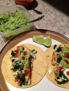 Fish tacos with slaw and guacamole.