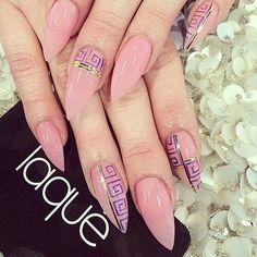 Pink stiletto nails w/ purple Greek key & gold stripes.