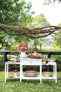 This pretty tableau allows guests to serve themselves while keeping clutter off the dining table. Indoor pieces like this wooden sideboard bring polish to an outdoor buffet. Outdoor Entertaining, Outdoor Fun, Outdoor Spaces, Outdoor Buffet, Southern Living Magazine, Outdoor Table Settings, Gallery Frames, Outdoor Retreat, Throw A Party