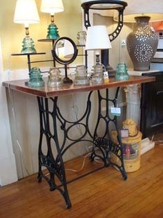 Repurposed treadle sewing machine and insulator lamps ... love to try these DIY's