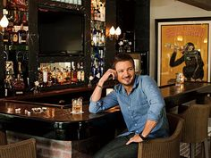 Jeremy Renner has the right idea with this home bar.