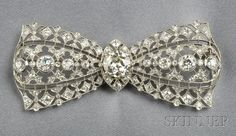 Art Deco Platinum and Diamond Bow Brooch. Auction 2586 | Lot 562 | Sold for $11,850