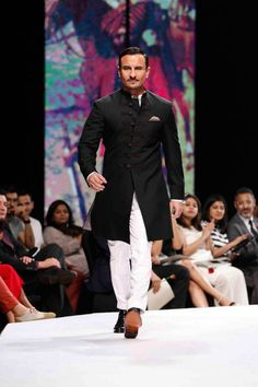 Saif Ali Khan in a black achkan at the Van Heusen GQ Fashion Nights Wedding Dresses Men Indian, Wedding Dress Men, Wedding Men, Wedding Suits, Mens Sherwani, Sherwani Groom, Wedding Sherwani, Indian Men Fashion, Gq Fashion