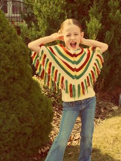 ponchos were cool in the70's.  Mom made mine////grandma made us all one mine was all colors so I could wear it with all......