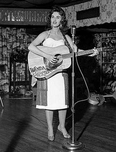 """July 1956 - Capitol Records signs up-and-coming rockabilly singer Wanda Jackson and releases """"I Gotta Know"""" which goes to #15 on the Country Charts."""