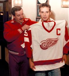 Red Wings coach Jacques Demers gives the Captain's jersey to Steve Yzerman at Oak Park Arena, Oct. 7, 1986. (Detroit News archive)
