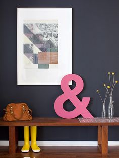"""In photographer Sarah Yates's home, the front door opens directly into her living room, """"so I used a bench to carve out the space and make it feel more like an entryway. It's a landing spot for our stuff, and also a place for our favorite accents—the ampersand and print were gifts from cherished friends."""" Courtesy of Sarah Yates and Lou Mora  - Redbook.com"""