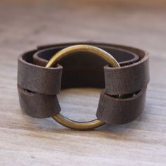 Make a stylish leather and brass ring bracelet perfect for everyday style.
