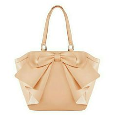 8848312e47 Luminating Tan purse Faux Leather tan purse with cute bow in front. Bag is  a great size, perfect for SPRING!