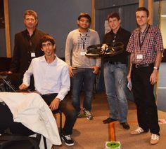 """L'équipe des """"Mini Drones"""" avec Ludovic Apvrille de Telecom ParisTech (tout à droite) & Jean-Luc Dugelay d'EURECOM (tout à gauche), lors de la présentation à SAME 2012 début octobre."""