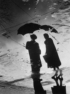 Paul wolff & Alfred Tritschler, man and woman with umbrella.