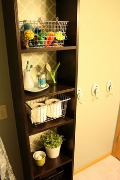 Storage shelf in bathroom for bath toys, toothbrush holder, toilet paper, extra towels, etc
