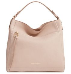 Ally by Salvatore Ferragamo. Clean lines underscore the elegant style of a spacious calfskin leather hobo cut in a relaxed silhouette and finished...